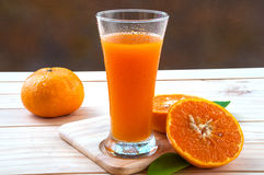 Cold orange juice. On wooden table stock photography