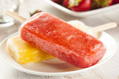 Cold Organic Frozen Strawberry Fruit Popsicle. With a stick Stock Image
