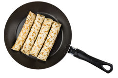 Cold pancakes with stuffing in frying pan isolated on white Stock Images
