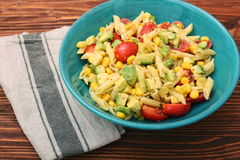 Cold pasta salad with avocado, tomato and olive oil. Healthy eating concept Royalty Free Stock Photography