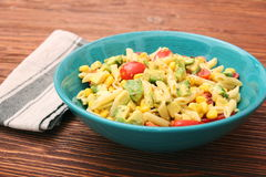 Cold pasta salad with avocado, tomato and olive oil. Healthy eating concept Royalty Free Stock Photo