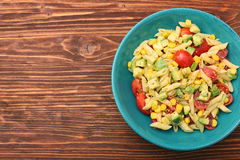 Cold pasta salad with avocado, tomato and olive oil. Healthy eating concept Stock Images
