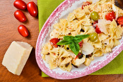 Cold pasta salad. Farfelle ribbon bow pasta with vegetables. A delicious, healthy salad Stock Photo