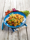 Cold pasta salad with pachino. Olives zucchins and pine kernel Stock Photography