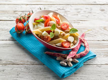 Cold pasta salad. With slice tomatoes mozzarella and beans Royalty Free Stock Image
