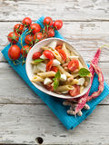 Cold pasta salad. With slice tomatoes mozzarella and beans Stock Photography