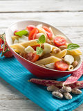 Cold pasta salad. With slice tomatoes mozzarella and beans Royalty Free Stock Photography