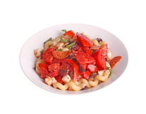 Cold pasta salad with tomatoes, olives, basil, pepperoni and moz. Plate of home-made, cold cavatappi or cellentani pasta salad (pasta fredda) with fresh basil Royalty Free Stock Photos