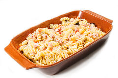 Cold pasta salad. On the white background Stock Photo