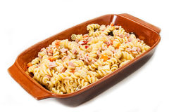Cold pasta salad. On the white background Stock Photos