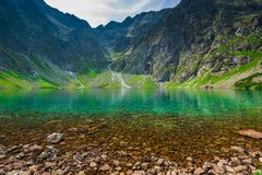 A cold picturesque mountain lake Czarny Staw in the high Tatra. Mountains in Poland stock photos