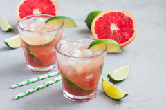 Cold pink cocktail with fresh grapefruit, lime, copy space Stock Image