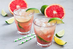 Cold pink cocktail with fresh grapefruit, lime and ice cubes Stock Photo