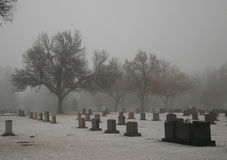 A Cold Place. A Cemetary covered in an early morning fog on a rather cold day Stock Photography