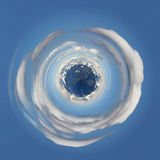 Cold planet. The snow-capped mountains as a planet floating in the sky area stock images