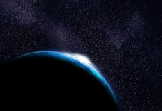 Cold Planet (in other galaxy) with rising sun. Somewhere in space. Alien Cold planet with sunrise in the foreground. Millions of stars at the background Stock Photo