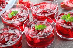 Cold pomegranate juice with ice cubes royalty free stock photos
