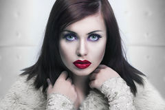 Cold portrait of a young lady with red lips Stock Image