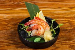 Cold prawn sashimi. With ginger and wasabi stock photography