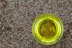 Cold pressed Linseed yellow oil on flaxseed Stock Images