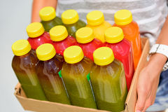 Cold-pressed organic raw vegetable juice bottles. Organic cold-pressed raw vegetable juice plastic bottles. Latest food trend consisting of juicing at high royalty free stock image
