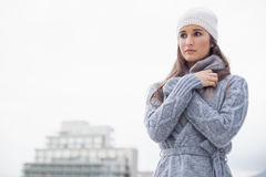 Cold pretty woman with winter clothes on posing Royalty Free Stock Images