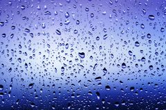 Cold rain drops on window. As background Stock Photography