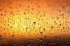 Cold rain drops on window. As background Stock Images
