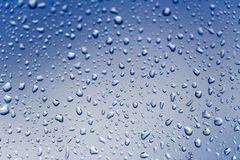 Cold rain drops on window Stock Images