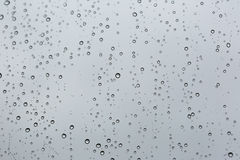 Cold rain drops on window. As background Royalty Free Stock Photography