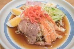 Cold ramen with shrimp, Japanese roast pork, ham, egg and cucumber Royalty Free Stock Image
