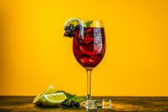 Free Cold Red Cocktail With Blackcurrant, Lemon, Mint And Ice In Tall Glass On Yellow Background. Summer Drinks And Alcoholic Cocktails Royalty Free Stock Photography - 161277427