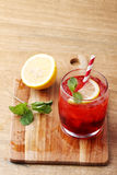 Cold red soft drink from raspberry syrup and mint Stock Image