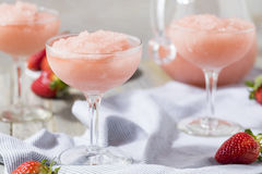 Cold Refreshing Frozen Rosé Wine Cocktail. Cold Refreshing Frozen Frosé Rosé Wine Cocktail in the Summer stock photography