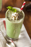 Cold Refreshing Mint Chocolate Chip MilkShake. With a Straw Stock Photography