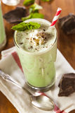 Cold Refreshing Mint Chocolate Chip MilkShake. With a Straw Stock Photo