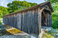 Cold River Bridge. The Cold River Bridge, also known as McDermott Bridge, is a historic wooden covered bridge over the Cold River in Langdon, New Hampshire. 81 Royalty Free Stock Images