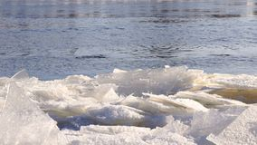 Cold river with a lof of small clusters of ice. Close-up of the surface of cold river with a lof of small clusters of ice in the foreground. Close-up stock video