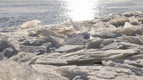 Cold river with a lof of small clusters of ice. Close-up of the surface of cold river with a lof of small clusters of ice in the foreground. Close-up stock footage