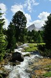 Cold river and mountains in the dolomites Stock Image