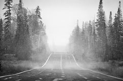 Cold road. Black and white photo of snow storm approaching Stock Photo