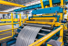 Cold rolled steel coil on decoiler of machine in metalwork manuf Royalty Free Stock Image