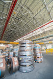 Cold rolled steel coils in storage area ready to feed to machine Stock Photos
