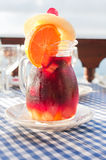Cold sangria in the glass jug with condensate Stock Photo