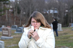 Cold and scared. Picture of a girl cold and scared in a cemetary Stock Photography