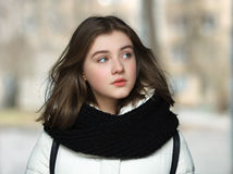 Cold season young curious beautiful woman close up portrait lifestyle concept Royalty Free Stock Images