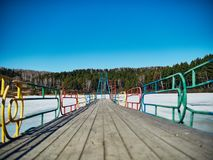 Cold Siberian landscape of a lake strained in the ice. Frozen lake and the path to the diving tower stock images