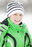 Cold smiling young boy in winter clothes Stock Photography