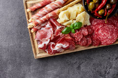 Cold smoked meat, cheese and olives Royalty Free Stock Image