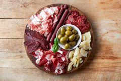 Cold smoked meat and cheese plate Royalty Free Stock Image